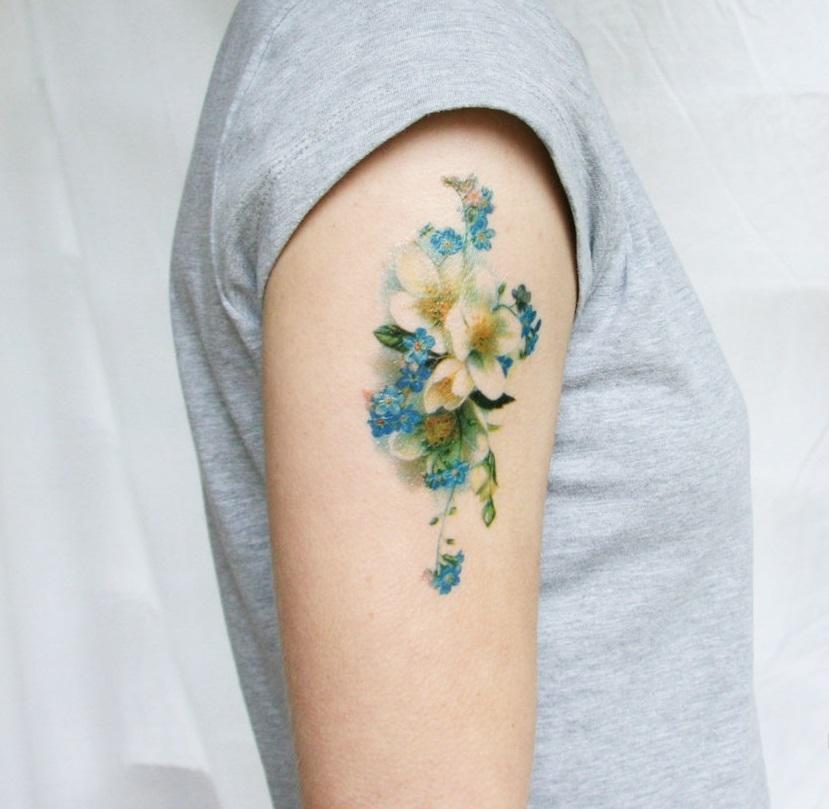 tattoo schouder dames lotus