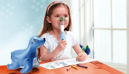 use of a nebulizer by a child